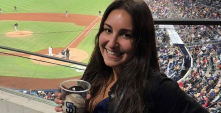 Gabby DiMarco catches foul ball in beer cup at San Diego Padres game in Petco Park in San Diego on June 5 2018
