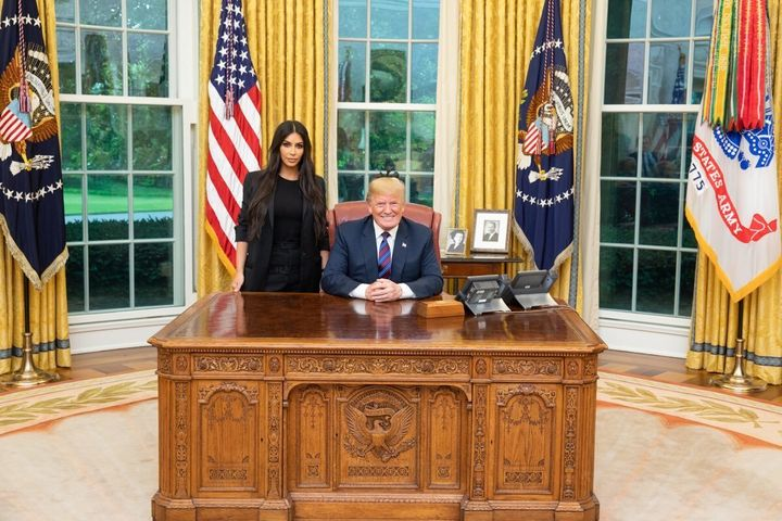 Kim Kardashian West appears in a photo with Donald Trump at the White House during a trip to discuss prison reform.