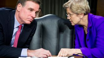 UNITED STATES - FEBRUARY 24: Sen. Mark Warner, D-Va., and Sen. Elizabeth Warren, D-Mass., talk before the start of the Senate Banking, Housing and Urban Affairs Committee hearing on 'The Semiannual Monetary Policy Report to the Congress' on Tuesday, Feb. 24, 2015. (Photo By Bill Clark/CQ Roll Call)