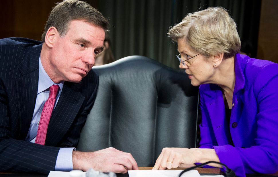Sens. Mark Warner and Elizabeth Warren are both Democrats on the Senate banking committee but were on opposite sides of a bil