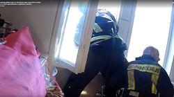 라트비아 소방대원들이 아파트에서 투신하려는 사람을 구조한