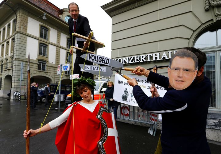 A demonstration promoting a switch to a sovereign money system, outside the Swiss National Bank offices in Bern in April 2017