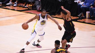 CLEVELAND,OH - June 6: Kevin Durant #35 of the Golden State Warriors handles the ball against the Cleveland Cavaliers in Game Three of the 2018 NBA Finals on June 6, 2018 at Quicken Loans Arena in Cleveland, Ohio. NOTE TO USER: User expressly acknowledges and agrees that, by downloading and/or using this photograph, user is consenting to the terms and conditions of the Getty Images License Agreement. Mandatory Copyright Notice: Copyright 2018 NBAE (Photo by Noah Graham/NBAE via Getty Images)