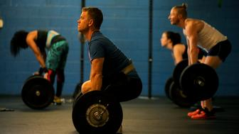 AURORA, CO - NOVEMBER 18: Ryan McNamara prepares to lift during a pre-workout of the day, strength training session at Lowry Fitness in Aurora, Colorado on November 18, 2015. Lowry Fitness offers CrossFit classes. (Photo by Seth McConnell/The Denver Post via Getty Images)