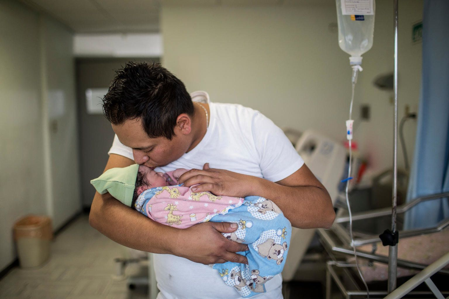 Yair Cruz, 26, holds his newborn baby girl and third child, Mia Gisele, at the Instituto Nacional de Perinatología hospital in Mexico City.