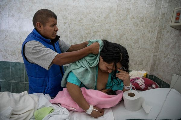 Gabino Macuixtle Macuixtle helps dry his wife's hair while Alberta Clemente Zepahua Namicle breastfeeds their recent child little one gi