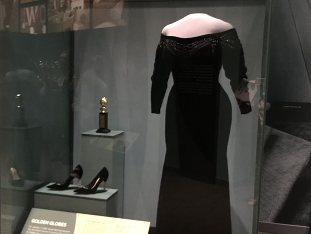 Oprah's dress and shoes, along with the Cecil B. DeMille Award, from the Golden Globes ceremony this