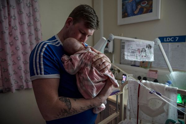 Jordan Bagshaw holds his 49-week-passe daughter Marley Rae Bagshaw, who used to be born in come, within the neonatal unit of the Royal