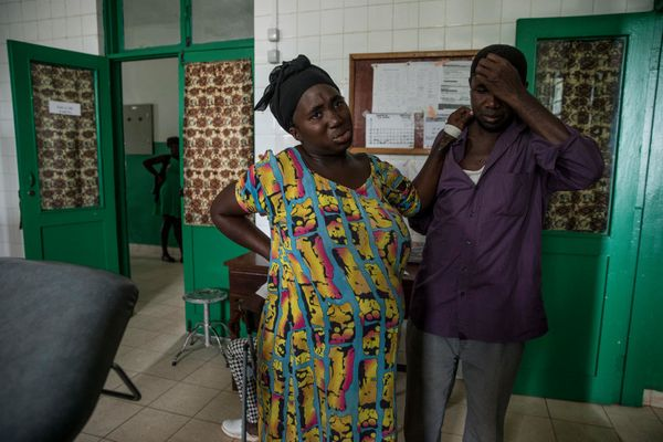 Aissatu Seidi leans against husband Mamudo Queta for toughen within the transport room at a hospital in Canchungo, in th