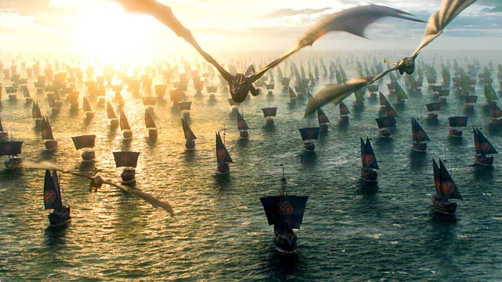 Just some dragons flying with ships