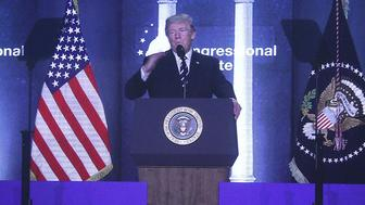 WHITE SULPHUR SPRINGS, WV - FEBRUARY 01:  As seen on a projection screen, U.S. President Donald Trump speaks during a lunch at the 2018 House & Senate Republican Member Conference February 1, 2018 at the Greenbrier resort in White Sulphur Springs, West Virginia. President Trump spoke to Congressional Republicans at the annual retreat two days after he gave his first State of the Union address to the nation.  (Photo by Alex Wong/Getty Images)