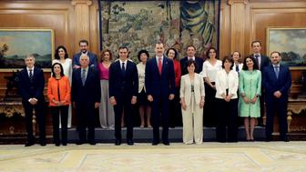 Spain's new cabinet members stand with King Felipe during a swearing-in ceremony at the Zarzuela Palace outside Madrid, Spain, June 7, 2018.  J.J. Guillen/Pool via Reuters