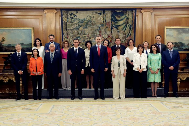 Spain's new cabinet members stand with King Felipe during a swearing-in ceremony at the Zarzuela Palace outside Madrid, Spain