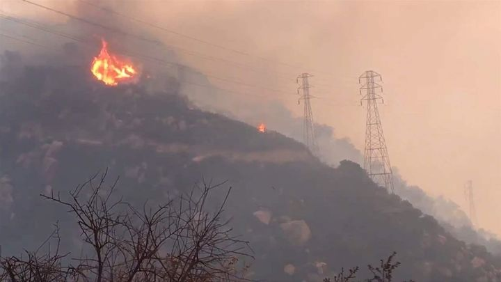 Spot fires burn near power lines in Santa Barbara, California, in December. Wildfires in Ventura and Santa Barbara counties t
