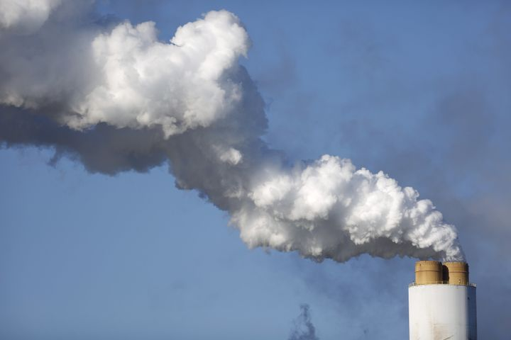 Emissions rise from the coal-fired Santee Cooper Cross Generating Station in Pineville, South Carolina.