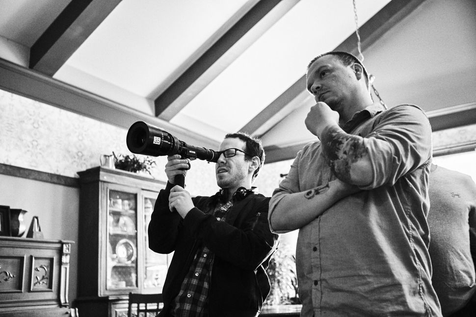 "Ari Aster and cinematographer Pawel Pogorzelski on the set of ""Hereditary."""