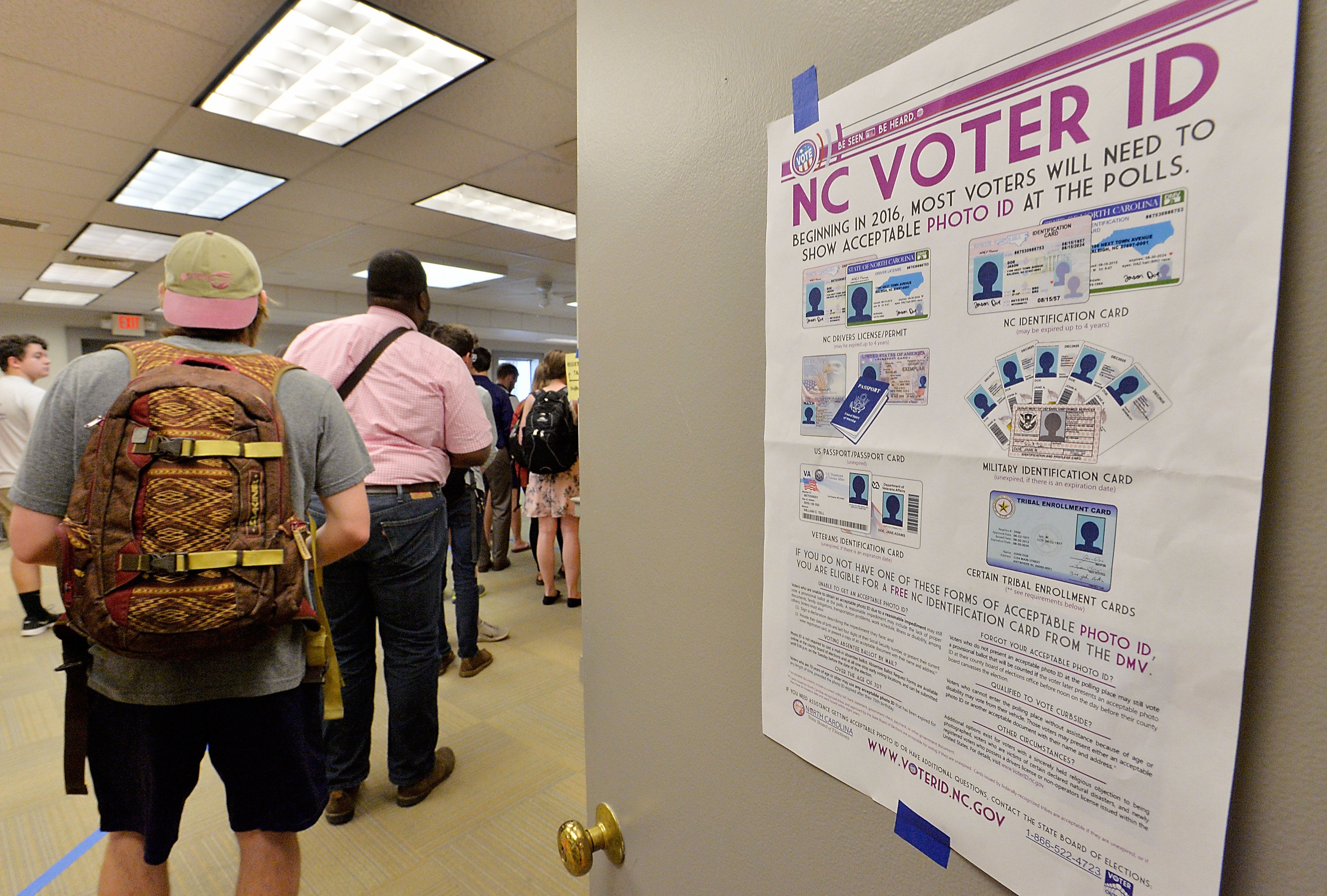 RALEIGH, NC - MARCH 15:  North Carolina State University students wait in line to vote in the primaries at Pullen Community Center on March 15, 2016 in Raleigh, North Carolina. The North Carolina primaries is the state's first use of the voter ID law, which excludes student ID cards. Wake County was among the highest use of provisional ballots, where those voters had home addresses on or near campuses. The Board of Elections will review voter's reasonable impediment form submitted with their provisional ballots to determine if their vote counts. The state's voter ID law is still being argued in federal court. (Photo by Sara D. Davis/Getty Images )