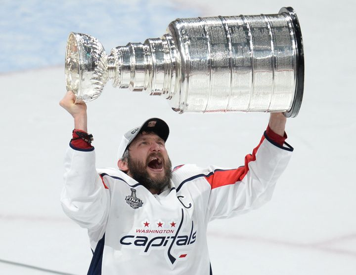 Washington Capitals left wing Alex Ovechkin hoists the Stanley Cup after defeating the Vegas Golden Knights in game