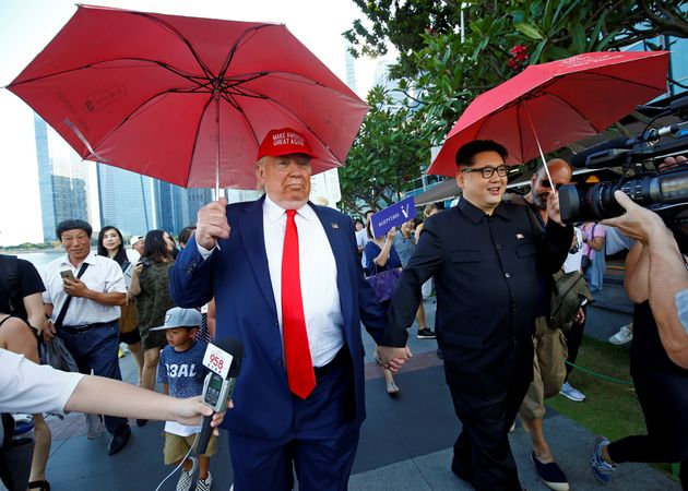 Donald Trump impersonator, Dennis Alan, pictured with an impersonator of Kim Jong Un in Singapore
