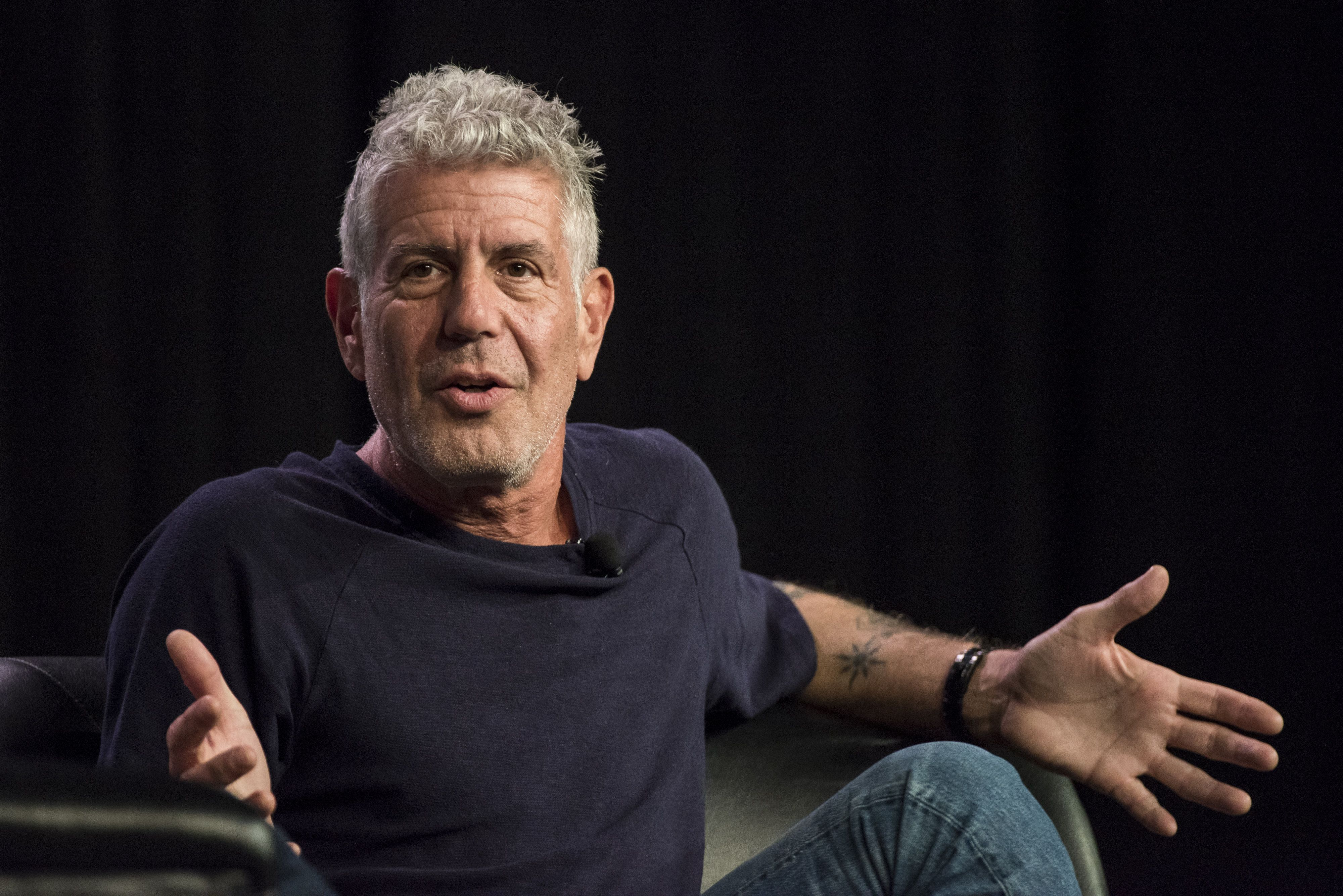Anthony Bourdain, host of CNNs Parts Unknown, speaks during the South By Southwest (SXSW) Interactive Festival at the Austin Convention Center in Austin, Texas, U.S., on Sunday, March 13, 2016. The SXSW Interactive Festival features presentations and panels from the brightest minds in emerging technology, scores of networking events hosted by industry leaders and a lineup of special programs showcasing new websites, video games, and startup ideas. Photographer: David Paul Morris/Bloomberg via Getty Images