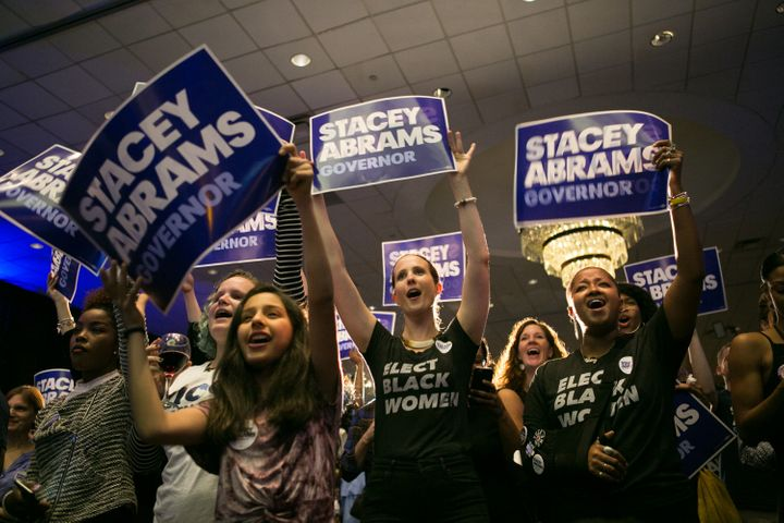 Supporters of Georgia Democratic gubernatorial candidate Stacey Abrams cheer during a rally in Atlanta on May 22. If elected