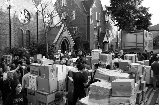 Volunteers sort through boxes of donations which have been collected in the aftermath of the Grenfell...