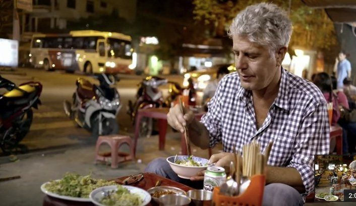 """Anthony Bourdaintastes Vietnamese street food in an episode of""""Parts Unknown."""" The celebrity chef has died"""