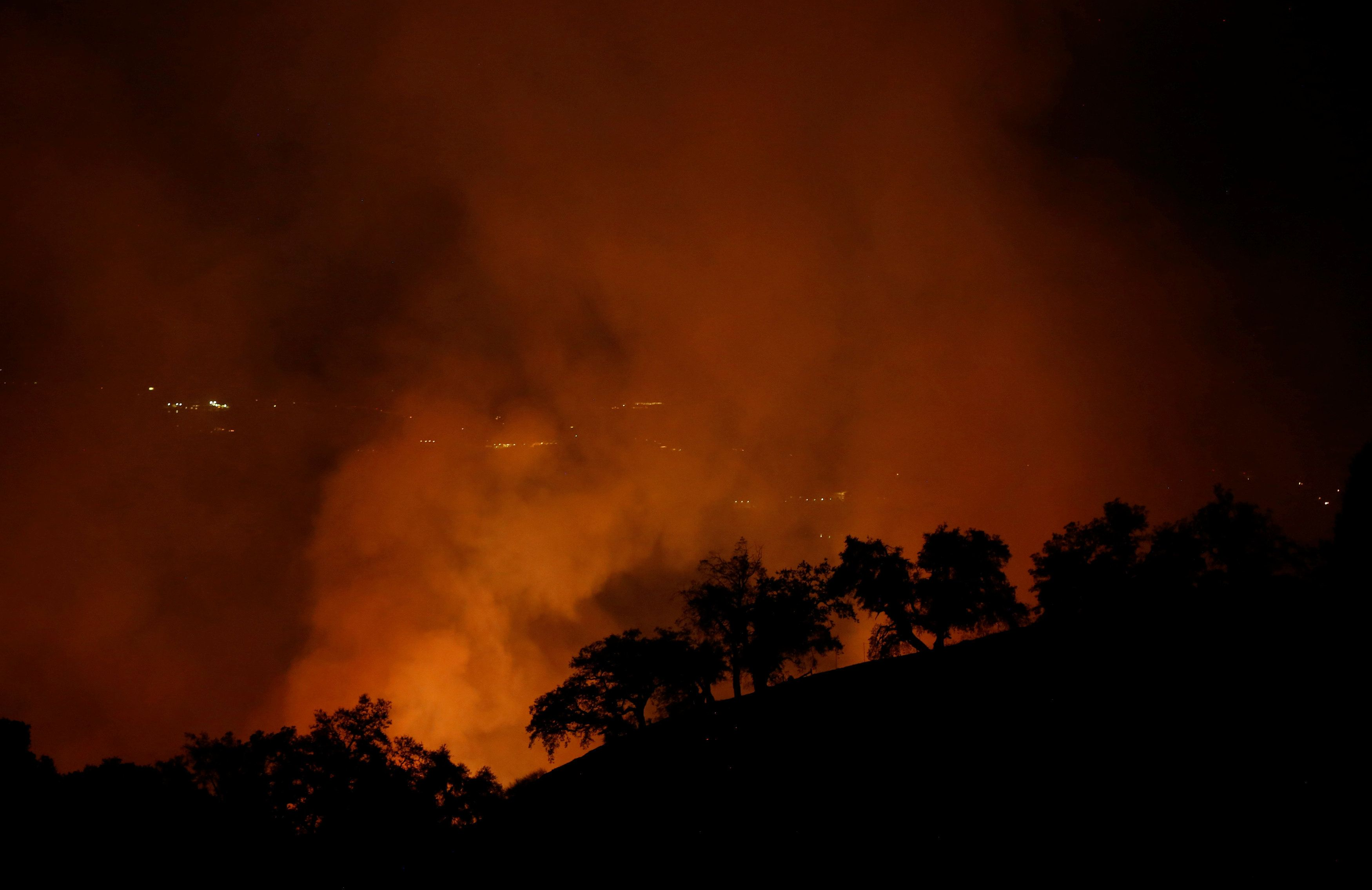 The Pocket wildfire burns in the hills above Geyserville, California, U.S., October 13, 2017. REUTERS/Jim Urquhart