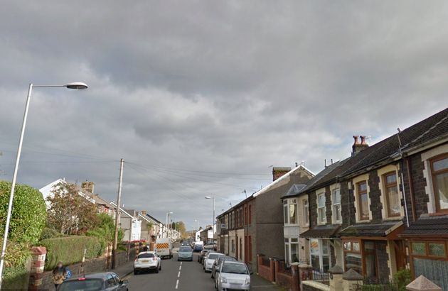 Brithweunydd Road in south wales has been closed off after a child was found death on Friday