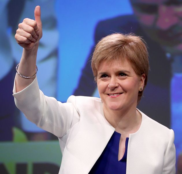 First Minister Nicola Sturgeon arrives on stage during the Scottish National Party's spring conference...