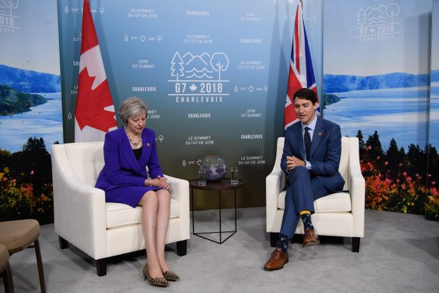 British Prime Minister Theresa May meets withCanadian Prime Minister Justin Trudeau on the first day of the G7 Summit