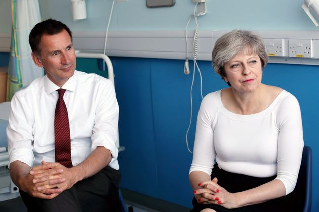 Prime Minister Theresa May and Health Secretary Jeremy Hunt speak to patients during a round table discussion...