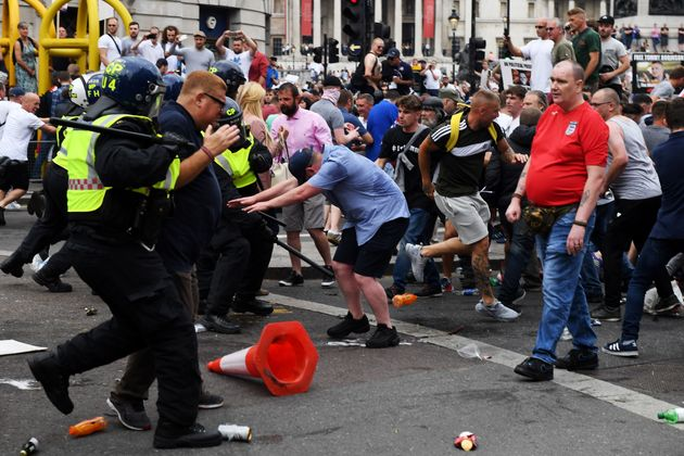 Demonstrators clash with police during rhe 'Free Tommy Robinson' protest on Whitehall
