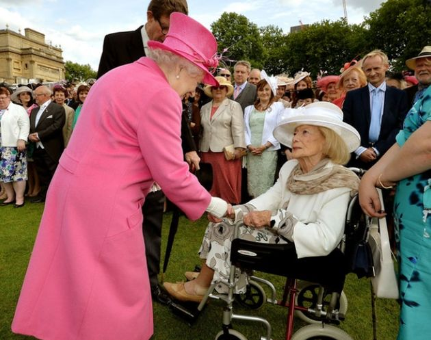 Turgel meeting the Queen at a Buckingham Palace garden party