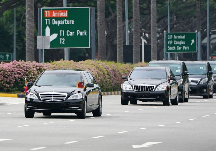 A motorcade believed to be carrying North Korea leader Kim Jong Un travels from the airport to the St. Regis Hotel in Singapore on Sunday.