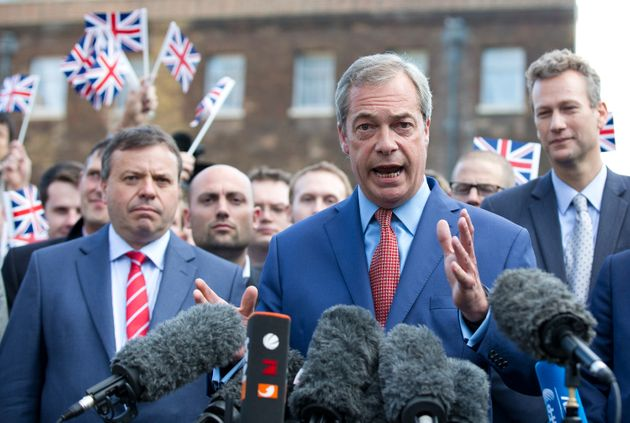 Leader of UKIP Nigel Farage, supported by Arron Banks (L), gives a press conference at College Green,...