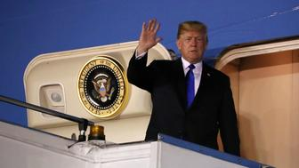 U.S. President Donald Trump waves as he disembarks Air Force One after arriving in Singapore June 10, 2018.  REUTERS/Jonathan Ernst