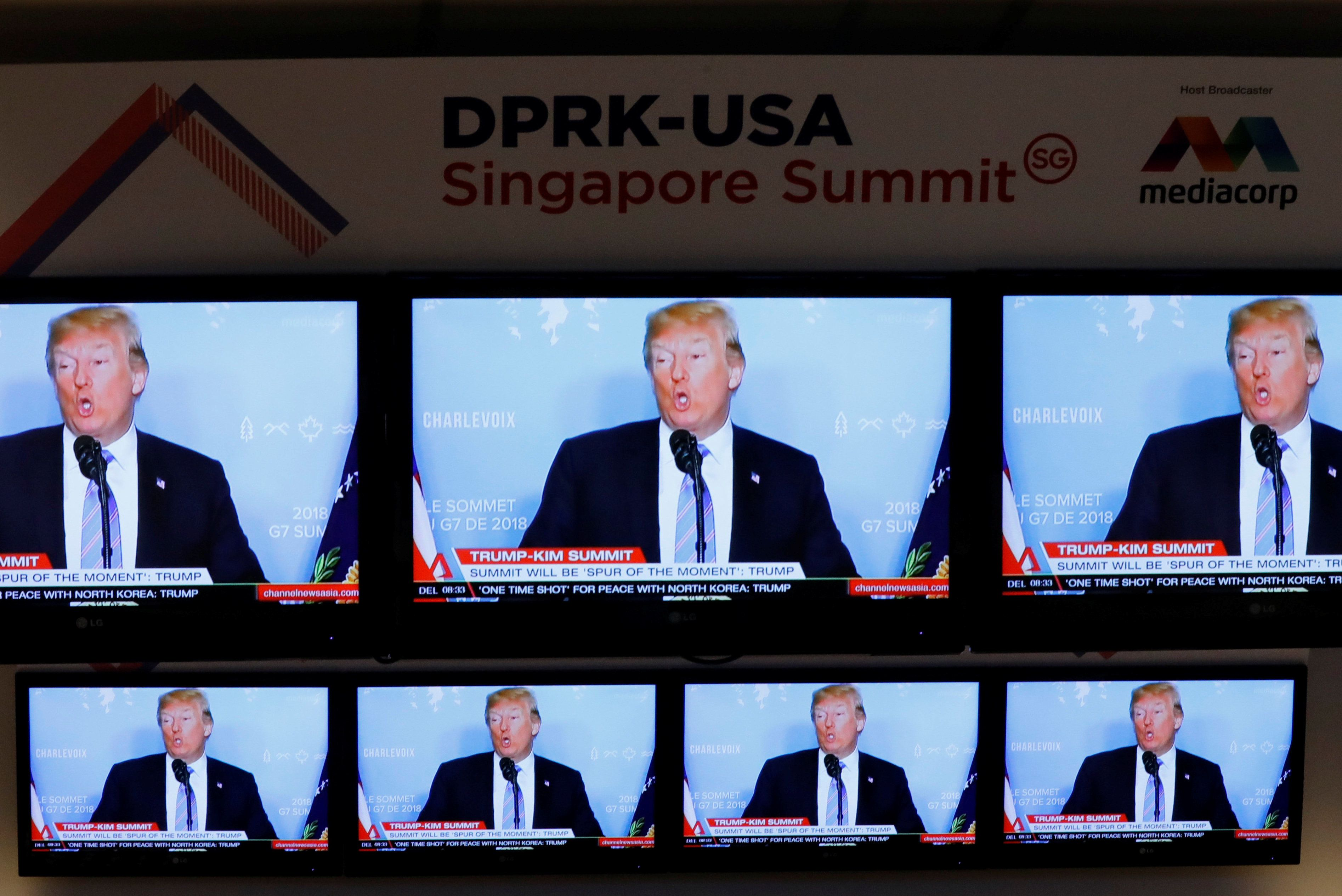 A TV news reports about U.S. President Donald Trump is projected on TV sets at a media center for the summit between the U.S and North Korea in Singapore, June 10,  2018.    REUTERS/Kim Kyung-Hoon