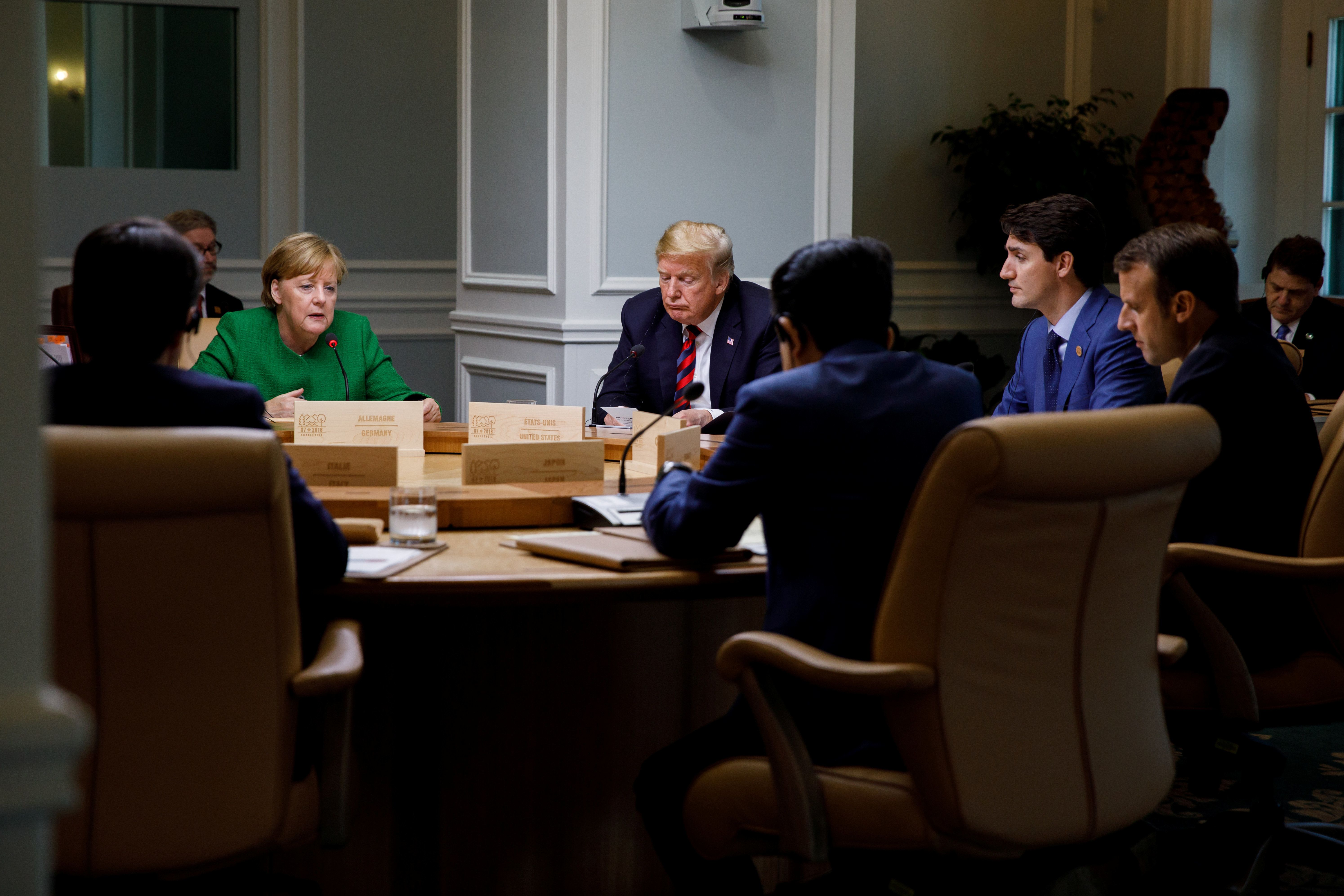Canada's Prime Minister Justin Trudeau and G7 leaders France's President Emmanuel Macron, Germany's Chancellor Angela Merkel, Japan's Prime Minister Shinzo Abe and U.S. President Donald Trump take part in a working session on the first day of the G7 meeting in Charlevoix city of La Malbaie, Quebec, Canada, June 8, 2018. Picture taken June 8, 2018.  Adam Scotti/Prime Minister's Office/Handout via REUTERS. ATTENTION EDITORS - THIS IMAGE WAS PROVIDED BY A THIRD PARTY.