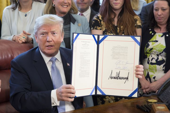 President Donald Trump signs FOSTA/SESTA on April 11, 2018.