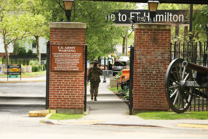 A soldier exits the Fort Hamilton military base in Brooklyn where a pizza delivery man was detained and questioned before bei