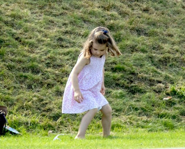 Princess Charlotte plays as her father, the Duke of Cambridge, takes part in the Maserati Royal Charity Polo Trophy.
