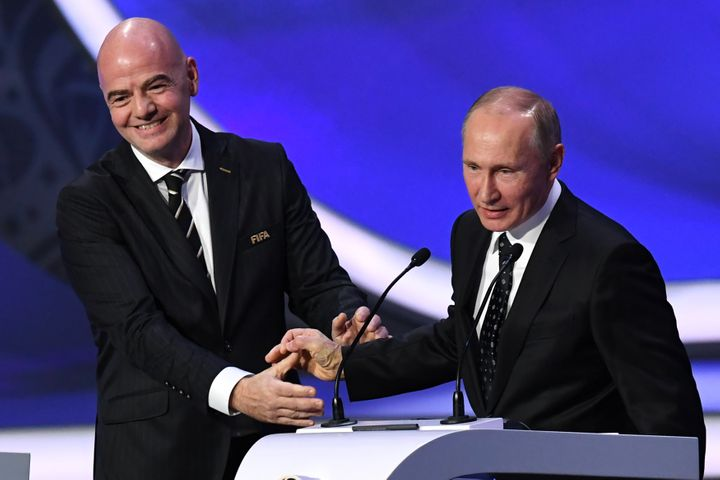 FIFA president Gianni Infantino smiles with Russian President Vladimir Putin while delivering speeches during the 2018 FIFA W