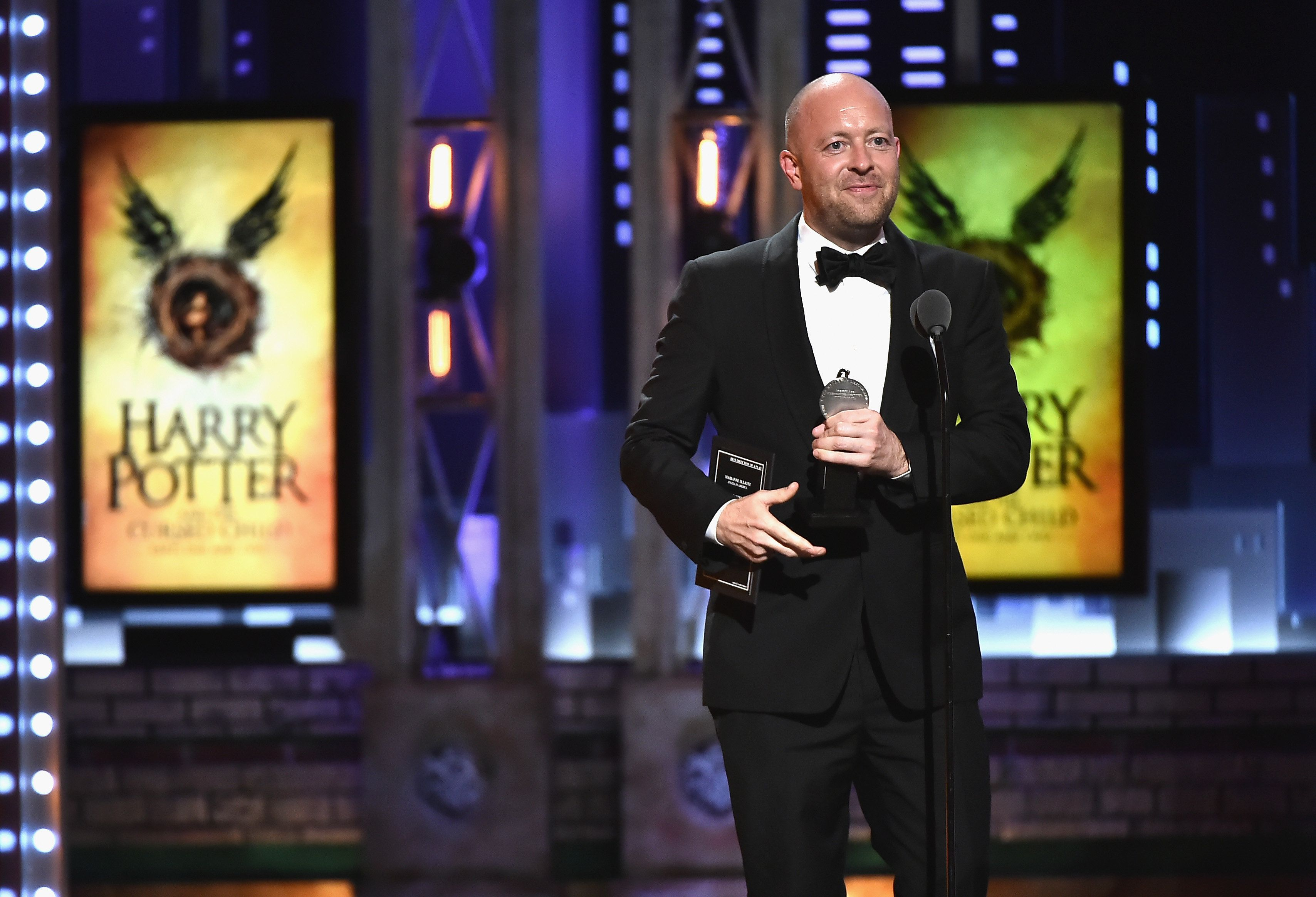 NEW YORK, NY - JUNE 10: John Tiffany accepts the award for Best Direction of a Play for Harry Potter and the Cursed Child, Parts One and Two onstage during the 72nd Annual Tony Awards at Radio City Music Hall on June 10, 2018 in New York City.  (Photo by Theo Wargo/Getty Images for Tony Awards Productions)