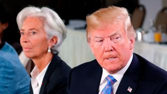 U.S. President Donald Trump, Managing Director of the International Monetary Fund Christine Lagarde and Germany's Chancellor Angela Merkel attend a G7 and Gender Equality Advisory Council meeting as part of a G7 summit in the Charlevoix city of La Malbaie, Quebec, Canada, June 9, 2018. REUTERS/Yves Herman