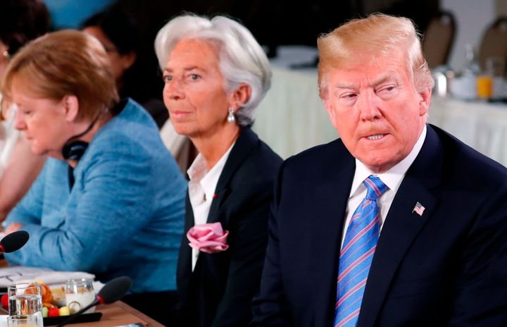 President Donald Trump, right, fired off a volley of tweets on Monday venting anger on NATO allies, the European Union and Ca