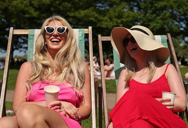 Grainne Gallanagh (left) and Ruth Chalke sunbathing in the hot weather on a Bank Holiday, in Hyde Park,