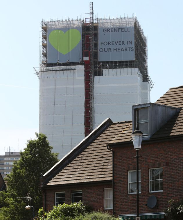 Banners are unveiled on the outside of Grenfell Tower ahead of the one-year