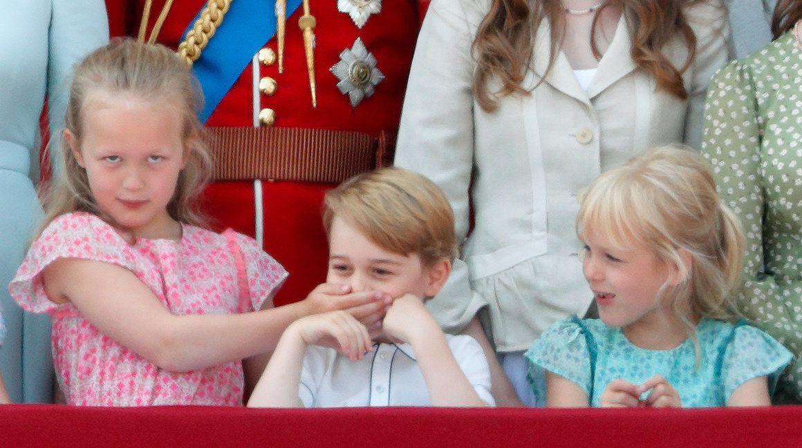 Savannah Phillips puts her hand over Prince George's mouth to keep her younger cousin quiet at Trooping the Color. The