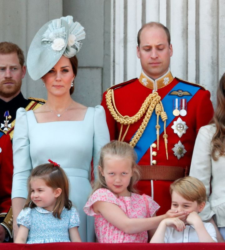 Prince William gives his son a disapproving look.